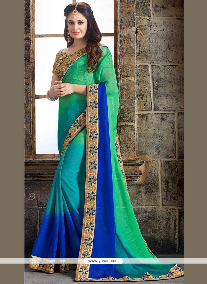 Baronial Blue And Sea Green Aari Work Faux Chiffon Classic Saree