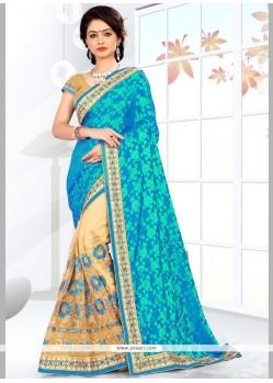 Hypnotizing Jacquard Silk Beige And Turquoise Resham Work Half N Half Saree
