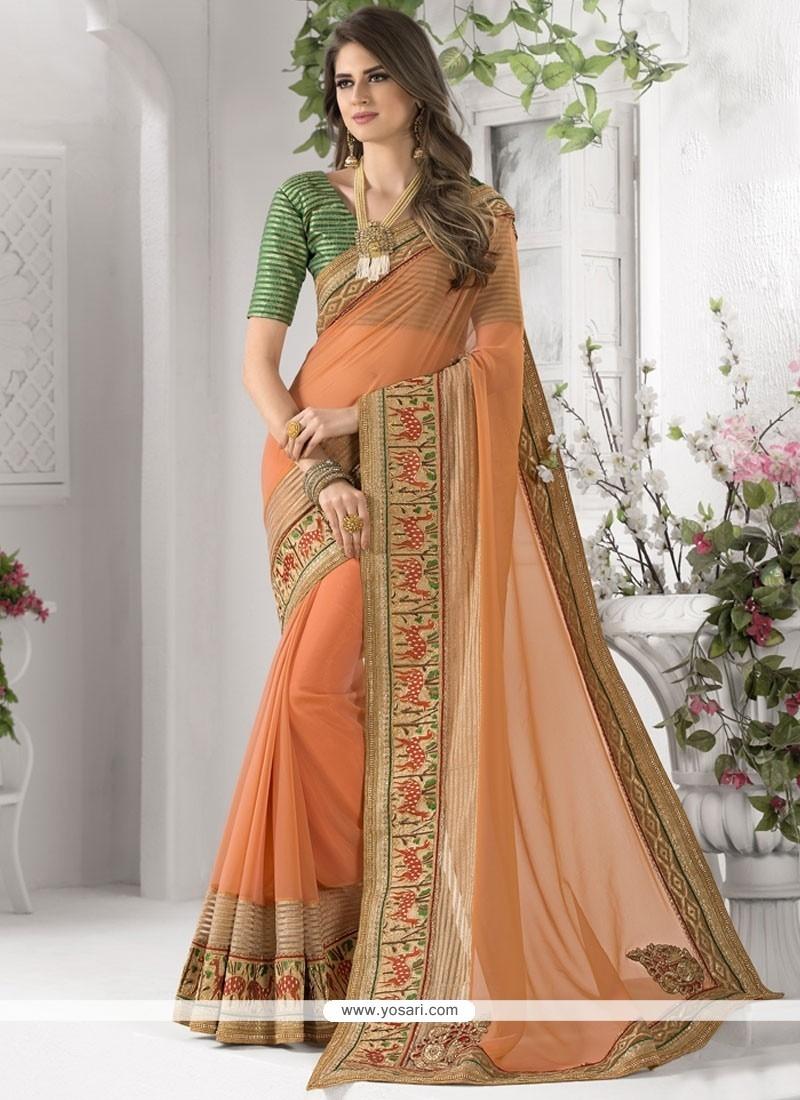 Remarkable Peach Zari Work Faux Georgette Classic Designer Saree