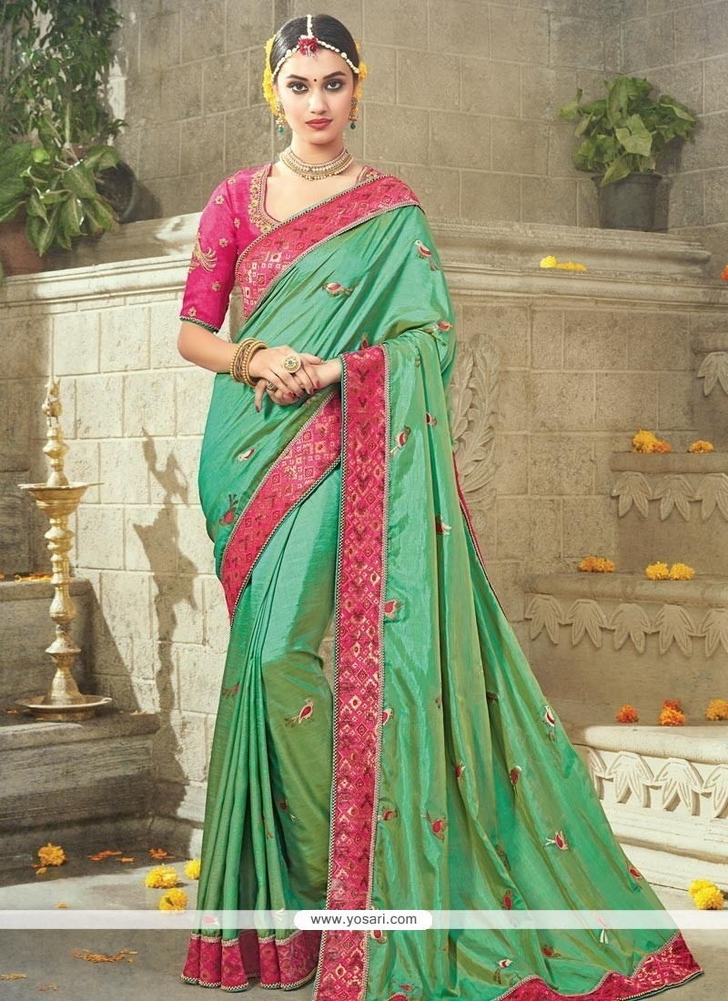 Delightful Art Silk Green Embroidered Work Traditional Saree