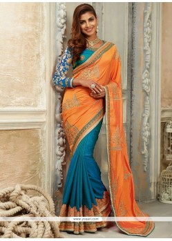 Exceeding Art Silk Blue And Orange Traditional Designer Saree