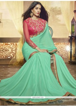 Thrilling Sea Green Patch Border Work Faux Georgette Saree