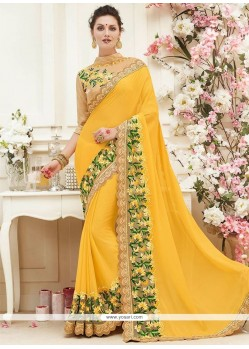 Patch Border Faux Chiffon Classic Saree In Yellow