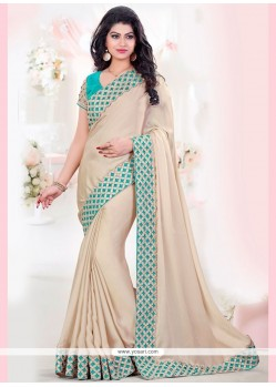 Dazzling Beige And Blue Embroidered Work Faux Georgette Designer Traditional Saree