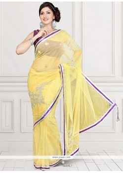 Thrilling Net Yellow Crystal Work Saree