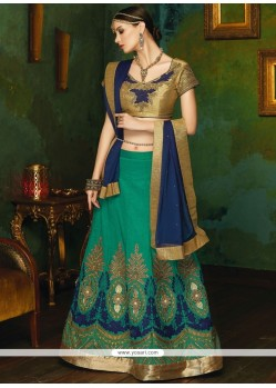Beckoning Navy Blue And Sea Green Patch Border Work Art Silk Lehenga Choli