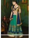 Beckoning Navy Blue And Sea Green Patch Border Work Art Silk Lehenga Choli
