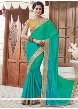 Energetic Sea Green Patch Border Work Faux Chiffon Designer Saree