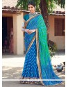 Immaculate Faux Georgette Blue And Sea Green Patch Border Work Shaded Saree