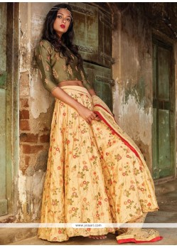 Fashionable Cream And Green Sequins Work Net Lehenga Choli