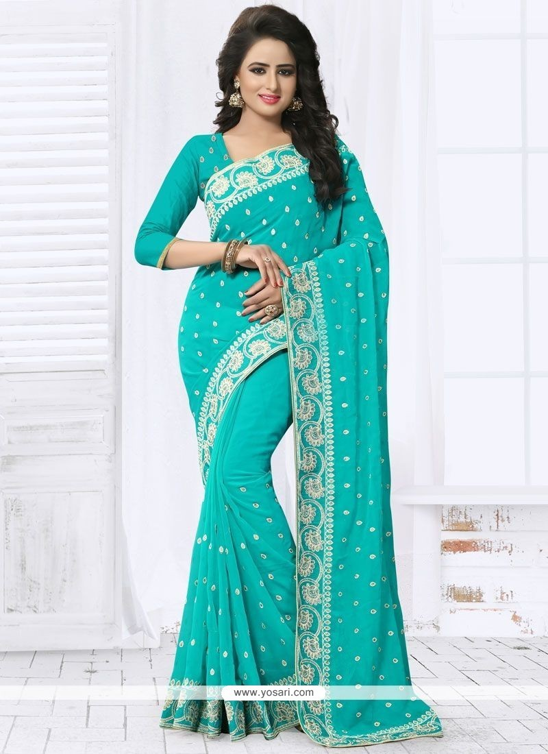 Exotic Embroidered Work Turquoise Faux Georgette Designer Saree