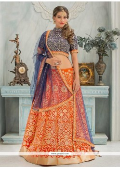 Ruritanian Floral Patterns Work Orange And Navy Blue Lehenga Choli