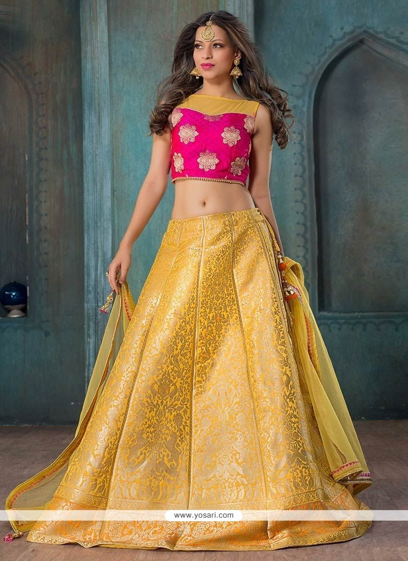 Compelling Jacquard Silk Yellow And Hot Pink Floral Patterns Work Lehenga Choli