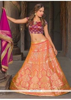 Invigorating Jacquard Silk Peach And Orange Floral Patterns Work Lehenga Choli