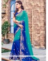 Capricious Blue And Sea Green Print Work Brasso Shaded Saree