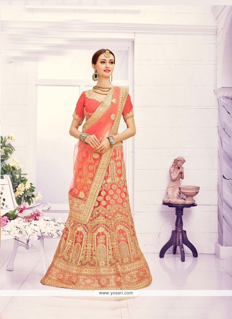 Tantalizing Net Peach Lace Work Lehenga Choli