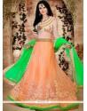 Alluring Green And Orange Lace Work Lehenga Choli