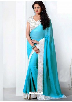 White And Sky Blue Crepe,Silk Saree