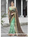 Brasso Brown And Sea Green Designer Half N Half Saree