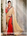 Amazing Cream And Orange Net Designer Saree