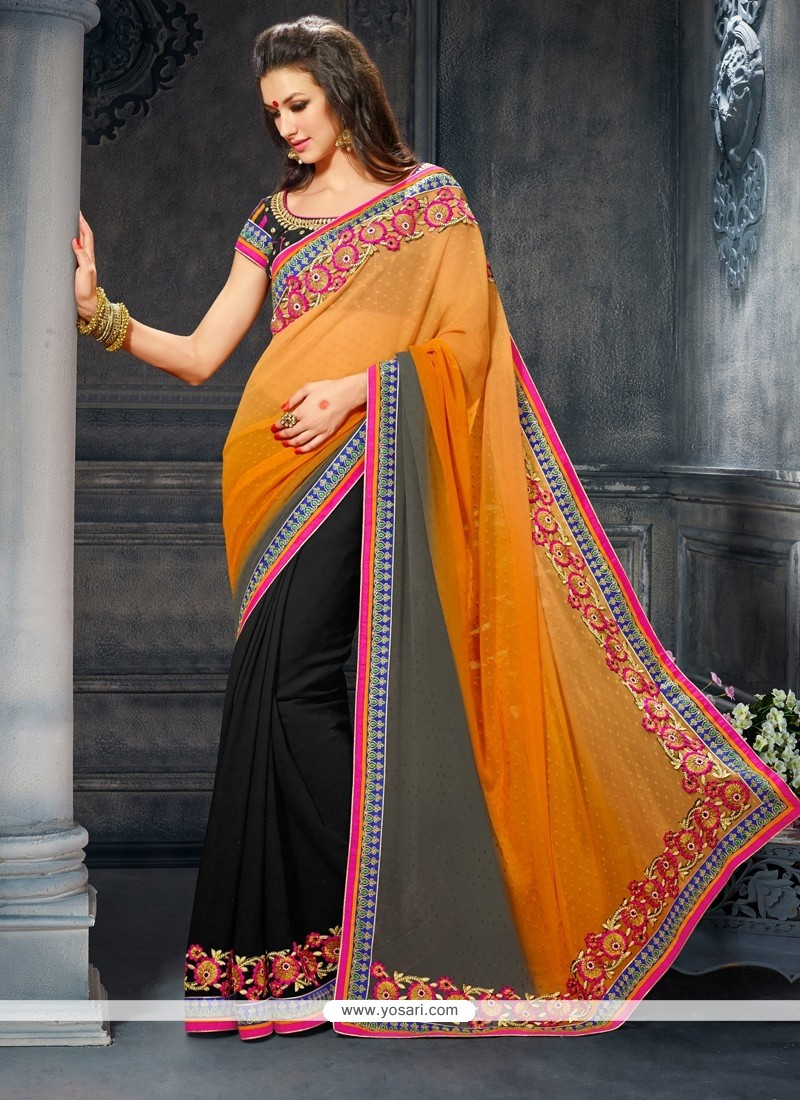 Pristine Black And Orange Georgette Party Wear Saree
