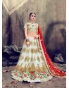 Stylish Off White Pure Silk Embroidered Lehenga Choli