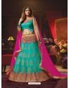 Radiant Turquoise Net Embroidered Lehenga Choli