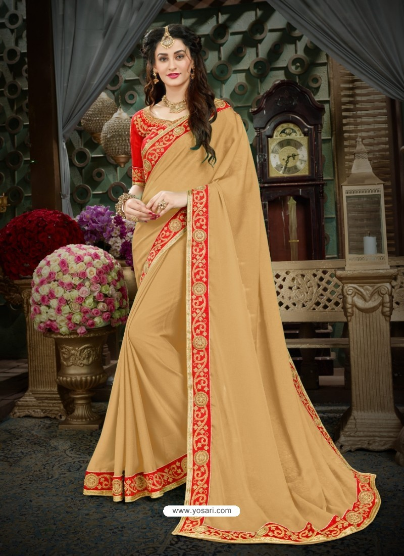 Magnificent Beige Georgette Embroidered Saree