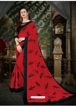 Delightful Crimson Georgette Embroidered Saree