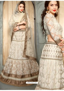 Remarkable Off White Net Embroidered Lehenga Choli