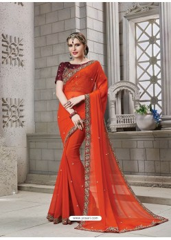 Orange Heavy Embroidered Georgette Designer Party Wear Saree