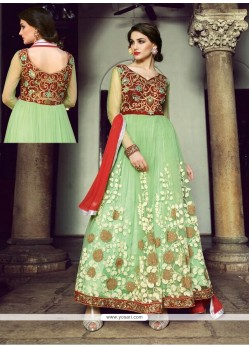 Stellar Green Net And Velvet Anarkali Suit