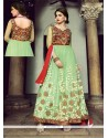 Stellar Green Net And Velvet Anarkali Suit