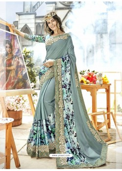 Silver Georgette Heavy Embroidered Party Wear Saree