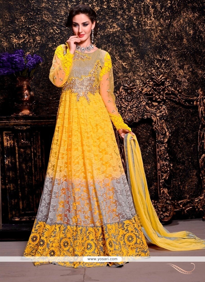 Exquisite Yellow Net And Brasso Anarkali Suit