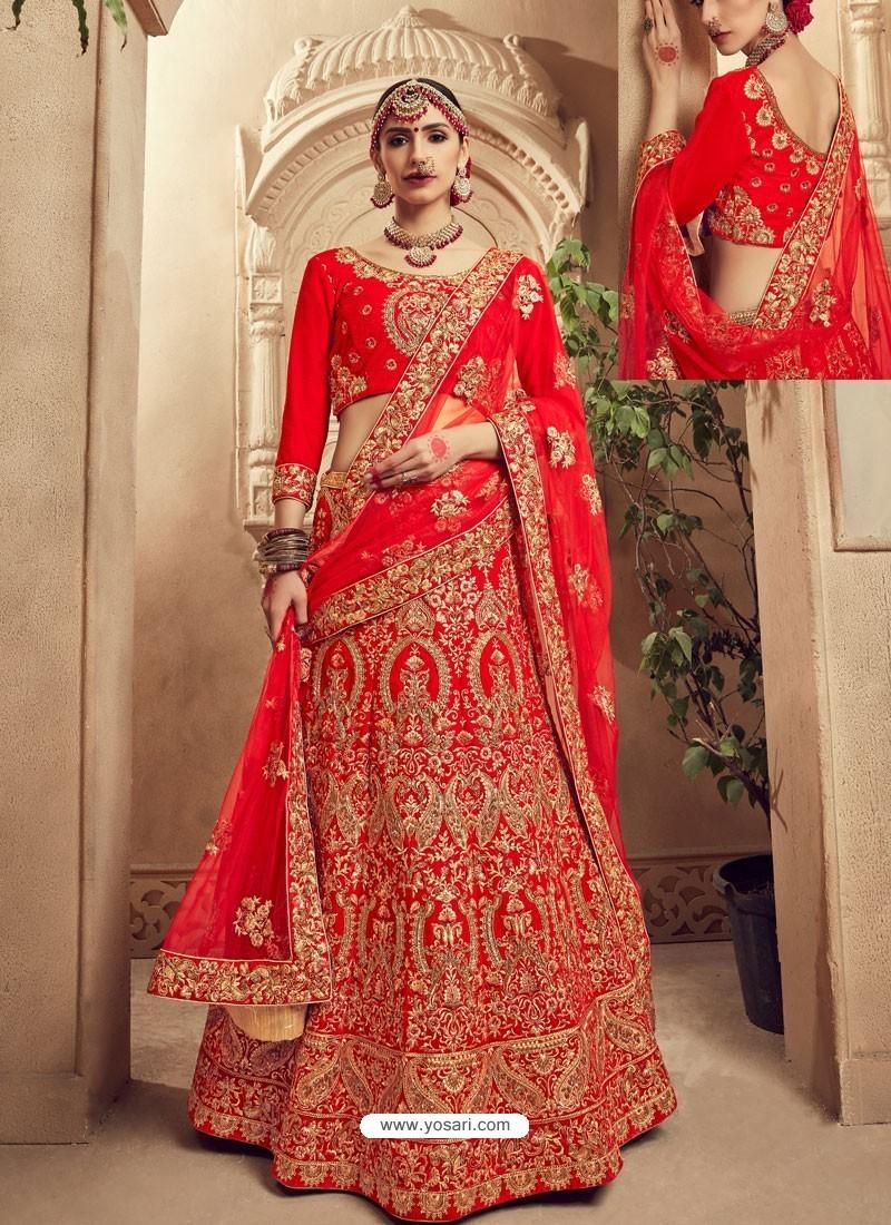 c778d9b68 Stunning Red Fancy Fabric Heavy Embroidered Designer Bridal Lehenga Choli