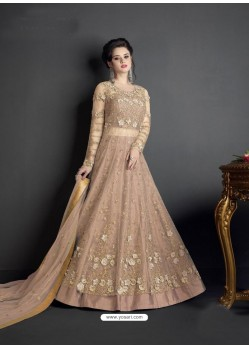 Beige Net Heavy Embroidered Floor Length Lehenga Suit