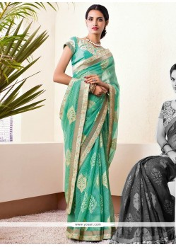 Turquoise Shaded Zari Brasso Georgette Saree