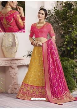 Yellow And Rani Raw Silk Stone Hand Worked Designer Lehenga Choli