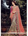 Lovely Peach And Grey Net Designer Saree