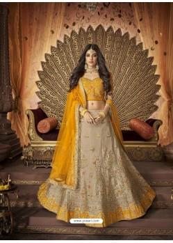 Glamorous Beige Silk Embroidery Designer Lehenga Choli