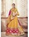 Scintillating Yellow Heavy Embroidered Wedding Lehenga Choli