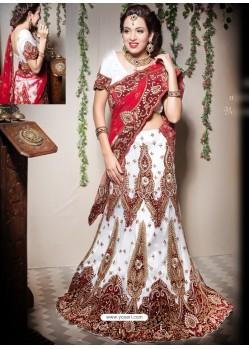 Scintillating Off White Heavy Embroidered Bridal Lehenga Choli