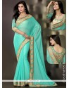 Turquoise Blue Chiffon And Art Silk Saree