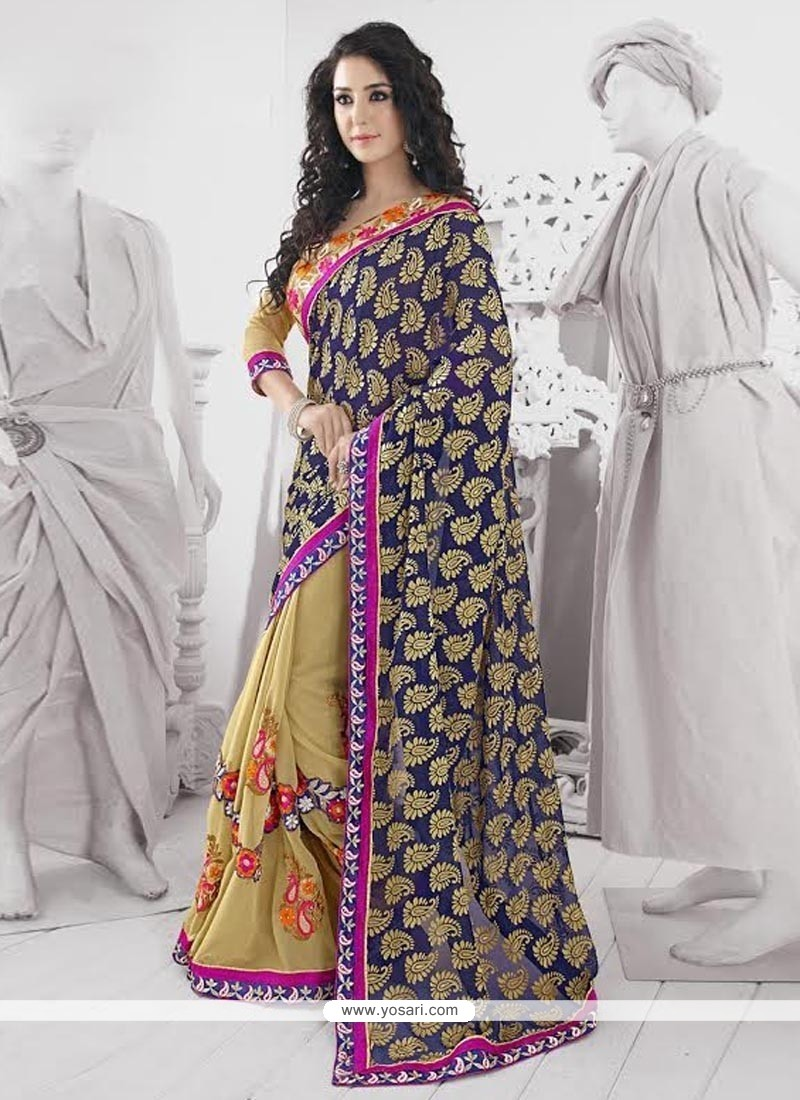 Exquisite Blue And Cream Georgette Saree