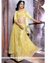 Whimsical Net Yellow Zari Work A Line Lehenga Choli
