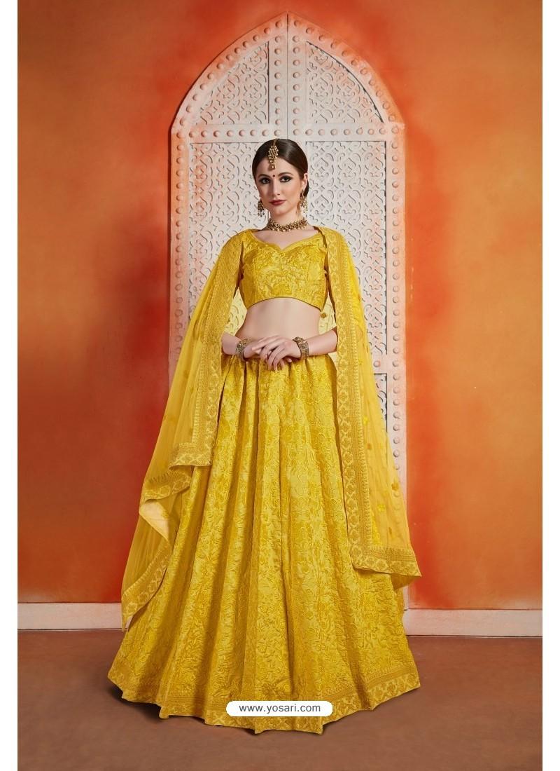 Yellow Heavy Embroidered Party Wear Designer Lehenga Choli