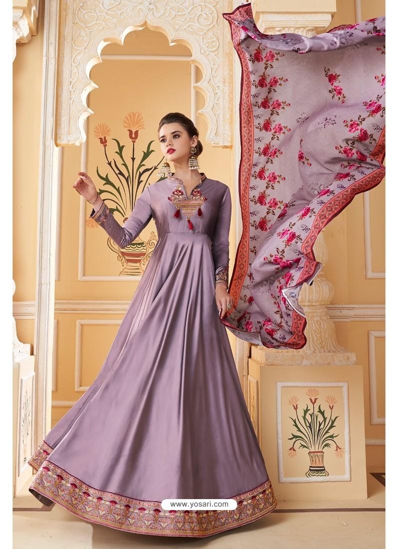 Lavender Heavy Embroidered Soft Silk Designer Gown Style Anarkali Suit