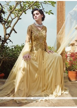 Graceful Cream Zari Work Net Designer Gown