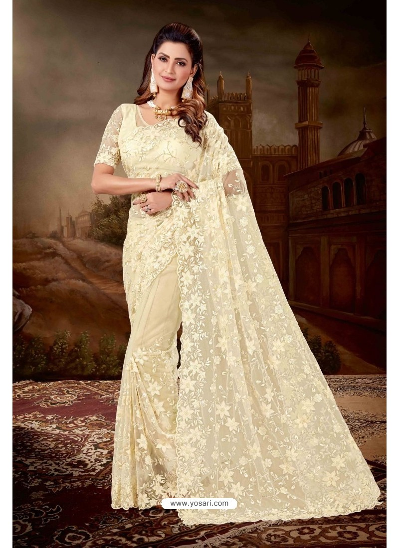 Cream Net Heavy Embroidered Party Wear Saree